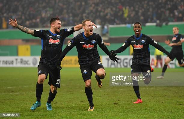 Ben Zolinski of Paderborn celebrates scoring his goal with Robin Krausse during the DFB Cup match between SC Paderborn and FC Ingolstadt at Benteler...