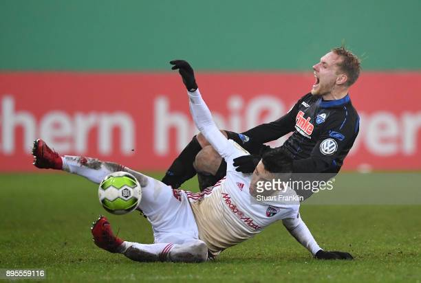 Ben Zolinski of Paderborn is challenged by Alfredo Morales of Ingolstadt during the DFB Cup match between SC Paderborn and FC Ingolstadt at Benteler...