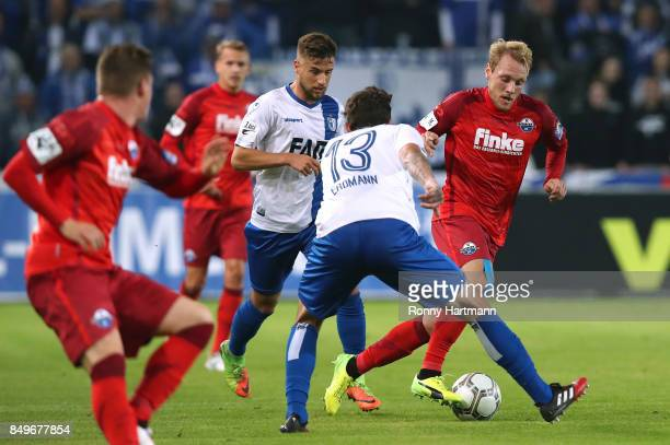 Ben Zolinski of Paderborn vies with Dennis Erdmann and Michel Niemeyer of Magdeburg during the 3 Liga match between 1 FC Magdeburg and SC Paderborn...