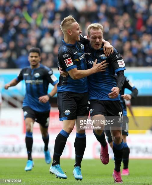 Ben Zolinski of SC Paderborn 07 celebrates with Kai Proger of SC Paderborn 07 after scoring his sides first goal during the Bundesliga match between...