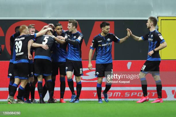 Ben Zolinski of SC Paderborn celebrates with his teammates after scoring his sides first goal during the Bundesliga match between SC Paderborn 07 and...