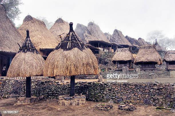 CONTENT] Bena Primitive Village on Flores Island In Central Flores traditional villages are in the shape of a circle of wooden houses facing a...