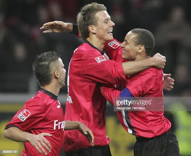 Benajmin Koehler Alex Meier and Jermaine Jones of Frankfurt celebrate Meiers 11 equalizer during the Bundesliga match between Eintracht Frankfurt and...