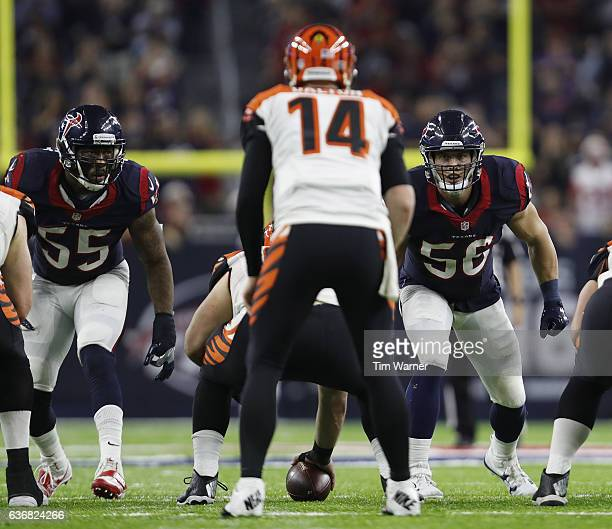 Benardrick McKinney of the Houston Texans and Brian Cushing of the Houston Texans stare at Andy Dalton of the Cincinnati Bengals in the fourth...