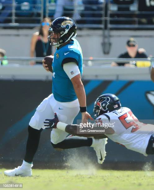 Benardrick McKinney of the Houston Texans attempts to tackle Blake Bortles of the Jacksonville Jaguars during the game at TIAA Bank Field on October...