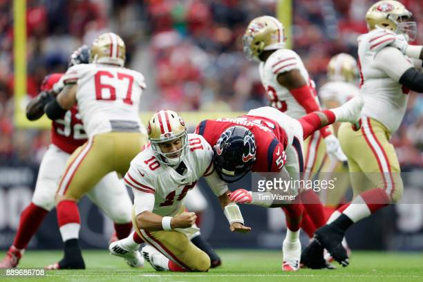 Benardrick McKinney of the Houston Texans drives Jimmy Garoppolo of the San Francisco 49ers to the ground after throwing a pass in the third quarter...