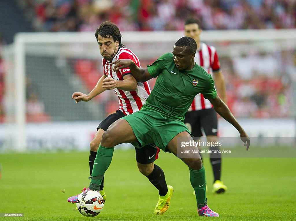 Benat Etxebarria of Athletic Club Bilbao duels for the ball with Simao Mate of Levante UD the La Liga match between Athletic Club and Levante UD at San Mames Stadium on August 30, 2014 in Bilbao, Spain.