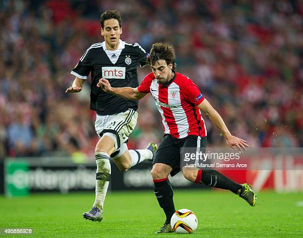 Benat Etxebarria of Athletic Club duels for the ball with Marko Jevtovic of FK Partizan during the UEFA Europa League match between Athletic Club and...