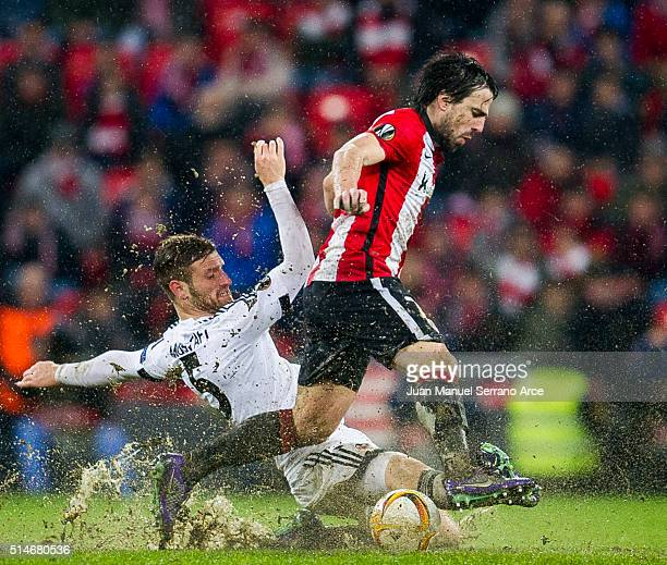 Benat Etxebarria of Athletic Club duels for the ball with Shkodran Mustafi of Valencia CF during the UEFA Europa League Round of 16 First Leg match...