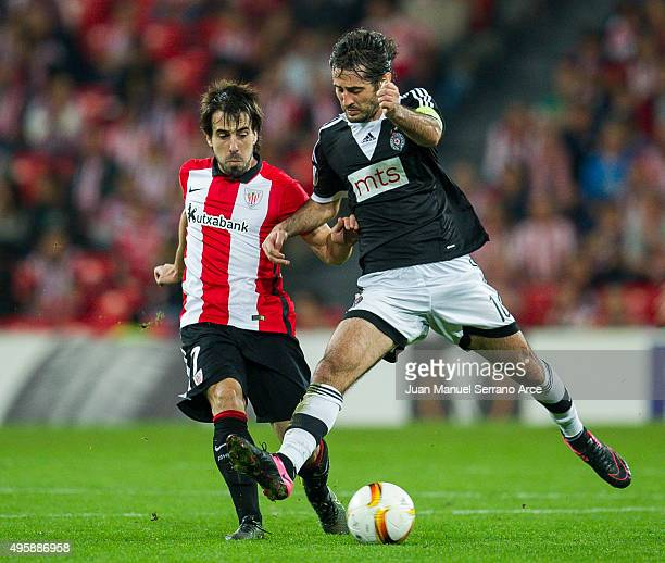 Benat Etxebarria of Athletic Club duels for the ball with Stefan Babovic of FK Partizan during the UEFA Europa League match between Athletic Club and...