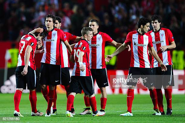 Benat Etxebarria of Athletic Club is conforted by his team mate Ander iturraspe of Athletic Club after missing his penalty in the shoot out during...