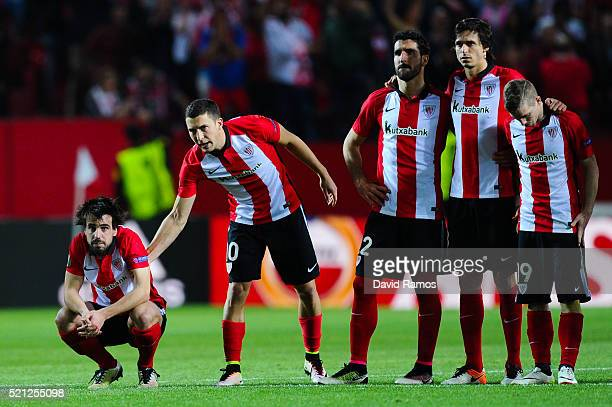 Benat Etxebarria of Athletic Club is conforted by his team mate Oscar de Marcos of Athletic Club after missing his penalty in the shoot out during...