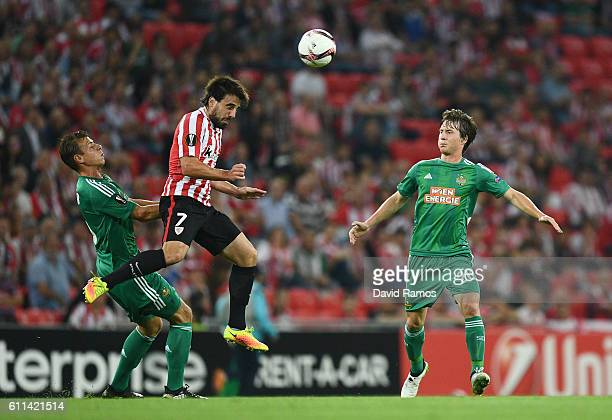 Benat of Athletic Bilbao wins a header under pressure Stefan Schwab and Ivan Mocinic of Rapid Vienna from during the UEFA Europa League group F match...