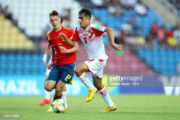 Benat Turrientes of Spain defends Rustam Soirov of Tajikistan during the FIFA U17 World Cup Brazil 2019 group E match between Spain and Tajikistan at...