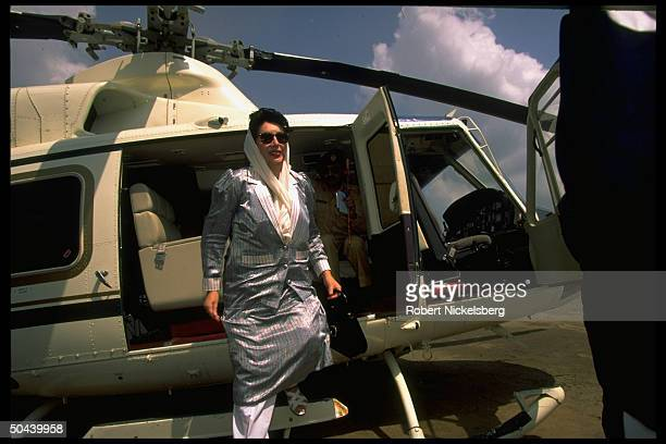 Benazir Bhutto arriving by copter to inaugurate natural gas pipeline & deliver speech to Pathan tribal audience; NW Frontier Province.