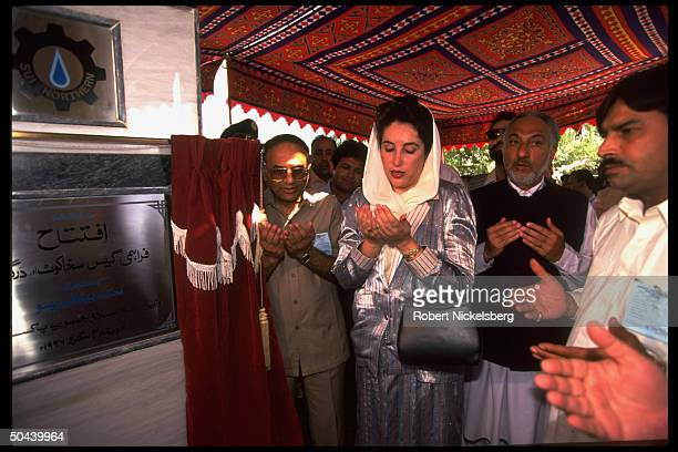 PM Benazir Bhutto striking prayerful cupping hands stance at ceremony inaugurating natural gas pipeline NW Frontier Province