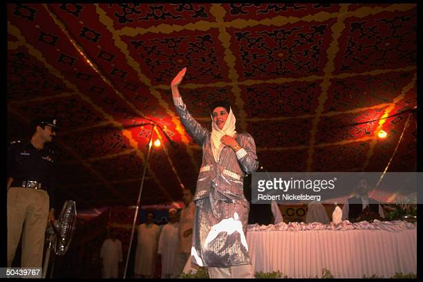 PM Benazir Bhutto waving during political event