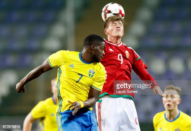 Bence Biro of Hungary U21 wins the ball from Isak Ssewankambo of Sweden U21 during the UEFA Under 21 Euro 2019 Qualifier match between Hungary U21...