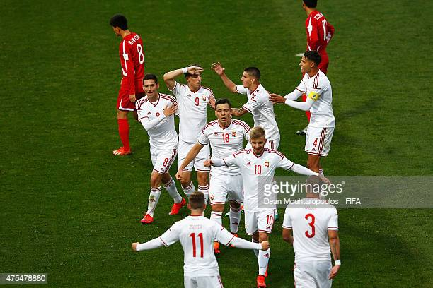 Bence Mervo of Hungary celebrates scoring his teams first goal with team mates during the FIFA U20 World Cup New Zealand 2015 Group E match between...