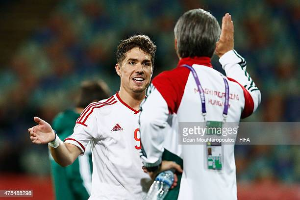 Bence Mervo of Hungary is congratulated by his coach Bernd Storck on the bench after scoring a hat trick during the FIFA U20 World Cup New Zealand...