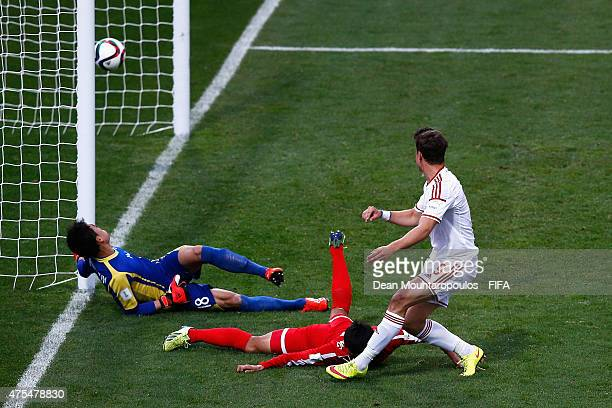 Bence Mervo of Hungary leaps and heads his teams first goal past goalkeeper Jo Sol Song of DPR Korea during the FIFA U20 World Cup New Zealand 2015...