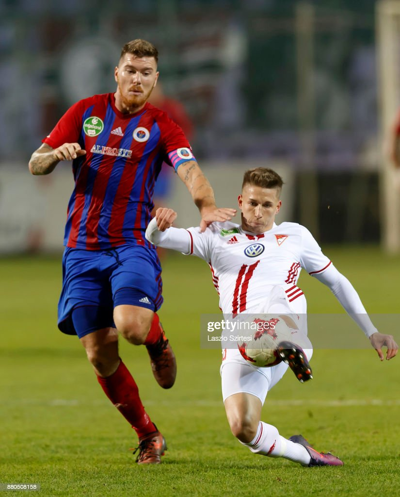 Bence Sos (R) of DVSC wins the ball from Martin Adam (L) of Vasas FC of DVSC during the Hungarian OTP Bank Liga match between Vasas FC and DVSC at Ferenc Szusza Stadium on November 25, 2017 in Budapest, Hungary.
