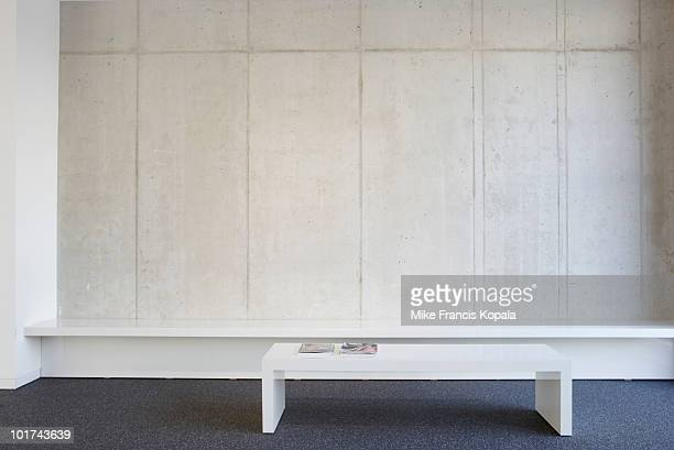 bench and table in modern office lobby - hotel lobby stock pictures, royalty-free photos & images
