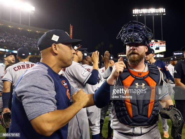 Bench coach Alex Cora and Brian McCann of the Houston Astros celebrate after winning Game 2 of the 2017 World Series against the Los Angeles Dodgers...