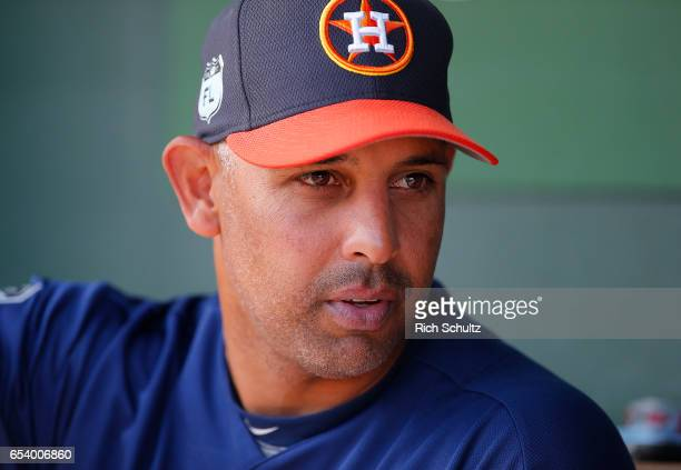 Bench coach Alex Cora of the Houston Astros looks on during a spring training game against the St Louis Cardinals at Roger Dean Stadium on March 9...