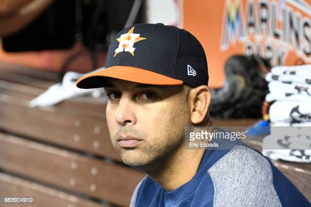 Bench coach Alex Cora of the Houston Astros sits in the dugout before the start of the game against the Miami Marlins at Marlins Park on May 16 2017...