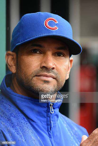 Bench coach Dave Martinez of the Chicago Cubs looks on from the dugout during the game against the Cincinnati Reds at Great American Ball Park on...