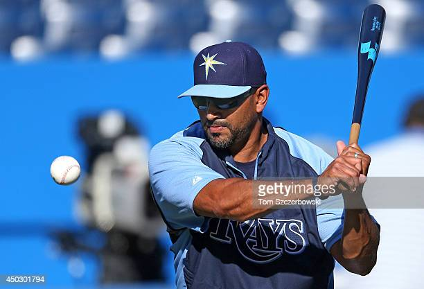 Bench coach Dave Martinez of the Tampa Bay Rays hits ground balls during batting practice before the start of MLB game action against the Toronto...