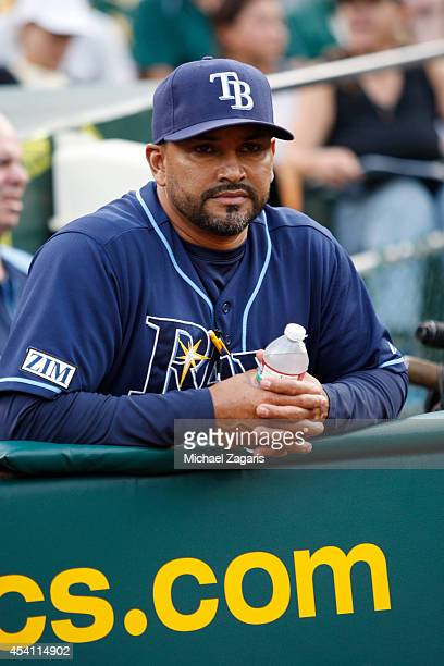 Bench Coach Dave Martinez of the Tampa Bay Rays stands in the dugout prior to the game against the Oakland Athletics at Oco Coliseum on August 4 2014...