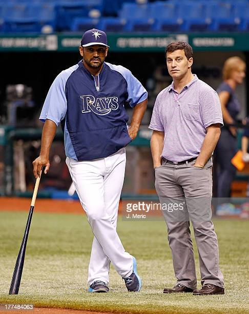 Bench coach Dave Martinez of the Tampa Bay Rays watches batting practice with Andrew Friedman Executive Vice President of Baseball Operations just...