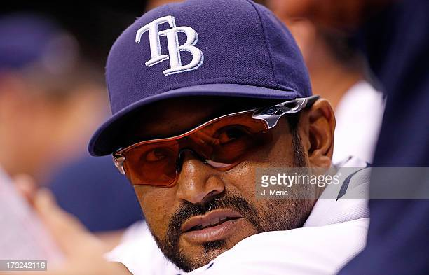 Bench coach Dave Martinez of the Tampa Bay Rays watches the game from the dugout against the Minnesota Twins during the game at Tropicana Field on...