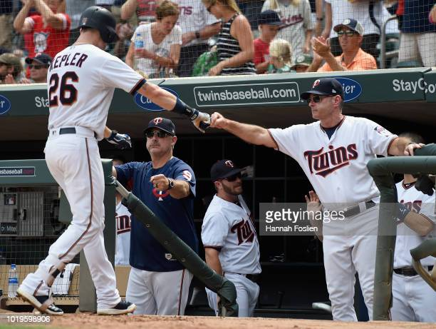Bench coach Derek Shelton and manager Paul Molitor of the Minnesota Twins congratulates Max Kepler on a solo home run against the Detroit Tigers...
