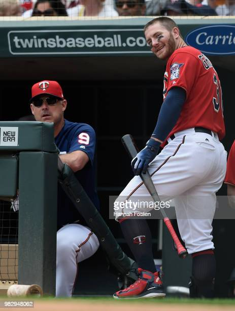 Bench coach Derek Shelton and Robbie Grossman of the Minnesota Twins react after Grossman was called out on strikes during the second inning of the...