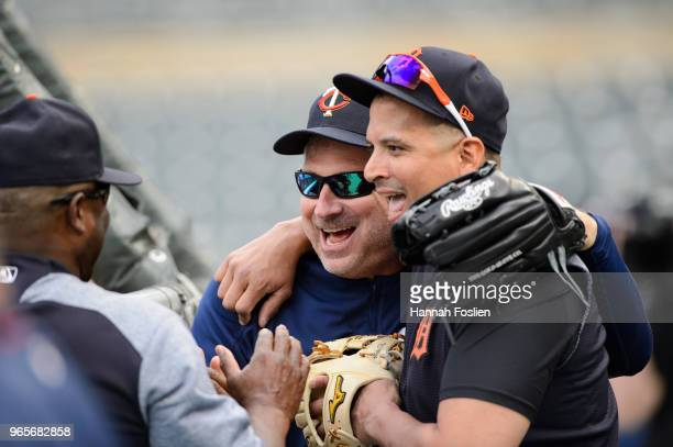 Bench coach Derek Shelton of the Minnesota Twins jokes with Victor Martinez of the Detroit Tigers during batting practice before the game on May 22...