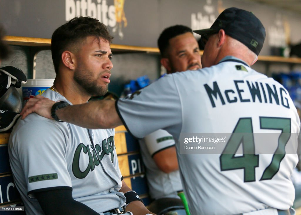 Bench coach Joe McEwing #47 of the Chicago White Sox talks with second baseman Yoan Moncada #10 of the Chicago White Sox during the fifth inning of a game against the Detroit Tigers at Comerica Park on May 27, 2018 in Detroit, Michigan. The Tigers defeated the White Sox 3-2.