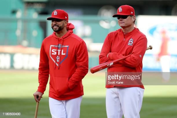 Bench coach Oliver Marmol and manager Mike Shildt of the St Louis Cardinals look on during batting practice prior to game one of the National League...
