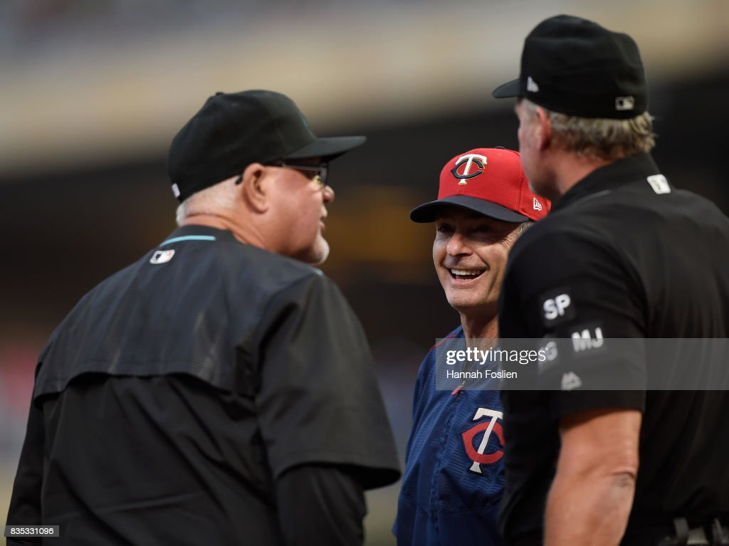 Bench coach Ron Gardenhire #35 of the Arizona Diamondbacks and manager Paul Molitor #4 of the Minnesota Twins exchange lineup cards with home plate umpire Ted Barrett #65 before the game on August 18, 2017 at Target Field in Minneapolis, Minnesota.