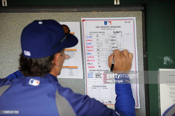 Bench coach Trey Hillman of the Los Angeles Dodgers fills out the lineup card before a spring training game the San Francisco Giants at Scottsdale...