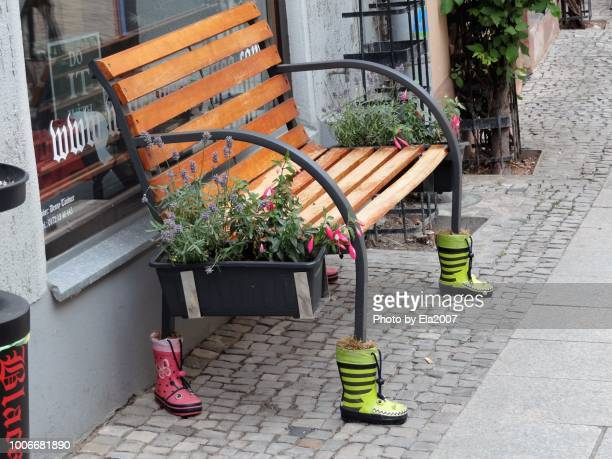Bench feet and rubber boots, art