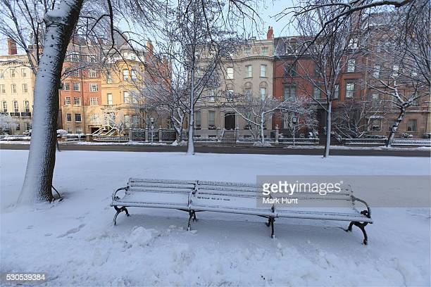 bench in a park after a snow storm, commonwealth avenue mall, back bay, boston, suffolk county, massachusetts, usa - after stock photos and pictures