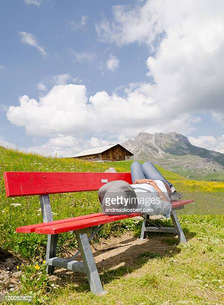 Bench in  Alps with Girl and Mountains