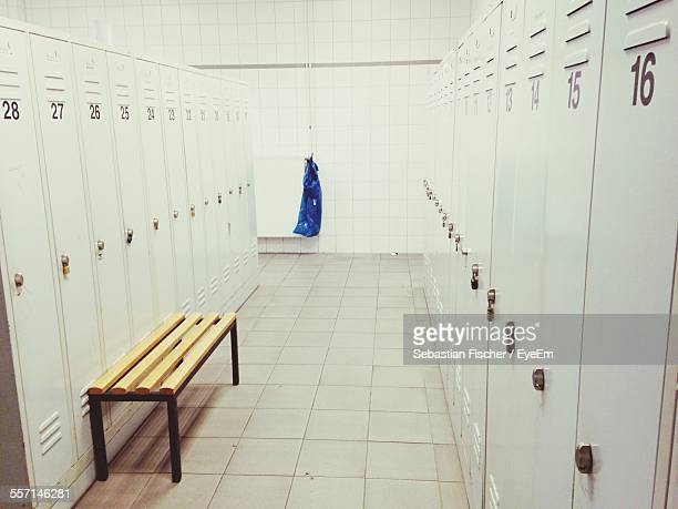 bench in empty locker room - locker room stock pictures, royalty-free photos & images