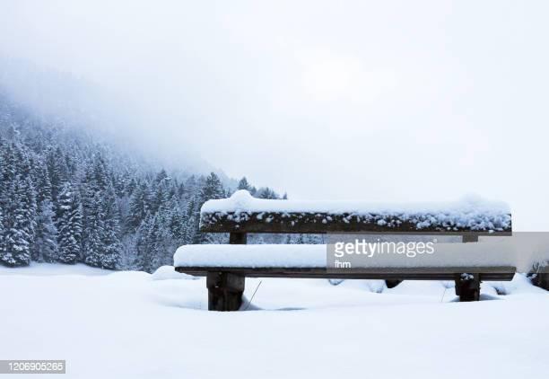bench in the snow - oberbayern stock-fotos und bilder