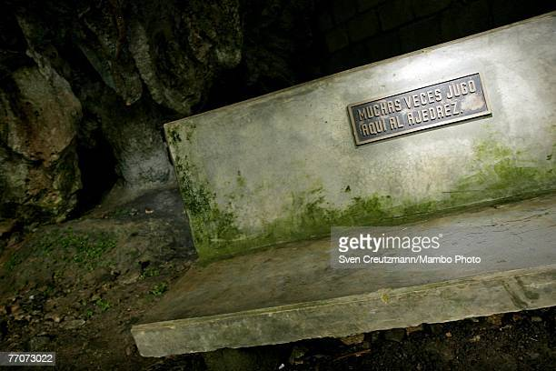 A bench is displayed at the comandancia headquarters of Ernesto Che Guevara on September 27 2007 in La Palma Cuba The bench bears a plaque reading...