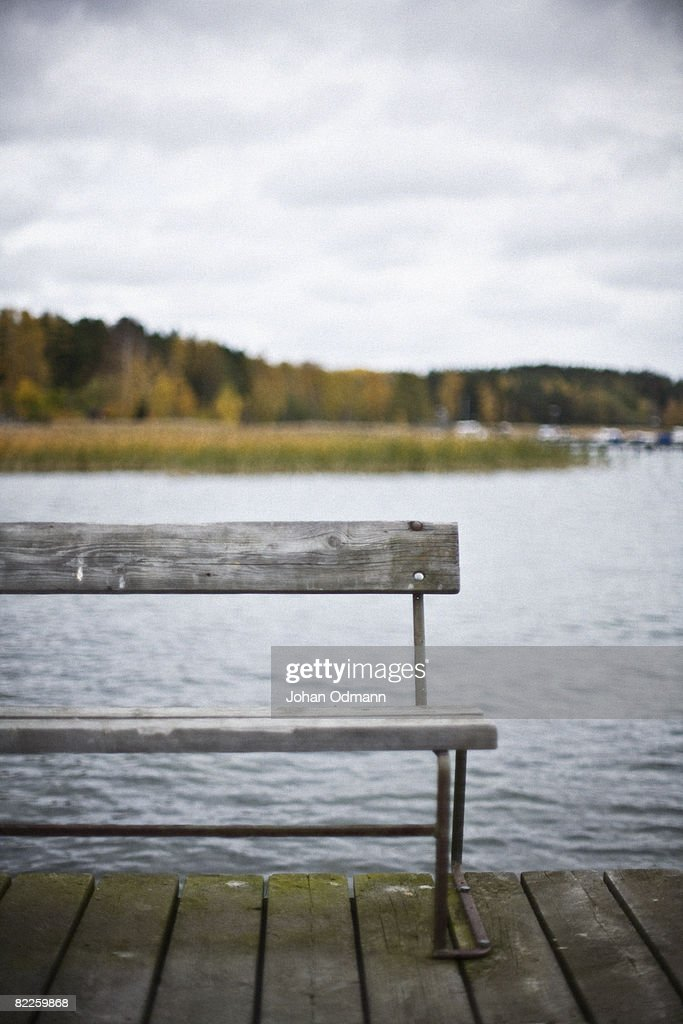 A bench on a jetty Sweden. : Stock Photo