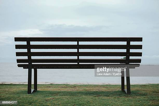 Bench On Grassy Field During Foggy Weather